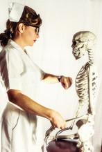 Vintage Nurse Taking A Skeleto...