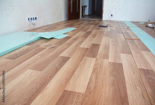 Fototapeta Laminate flooring interior. Installing wooden laminate flooring. obraz na płótnie