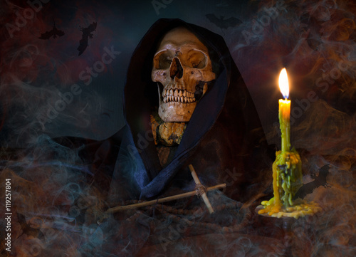 Photo  Skull and candle light with Christian crucifix in dark Halloween