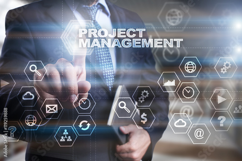 "Fotografía  Businessman is pressing on the virtual screen and selecting ""Project management"""
