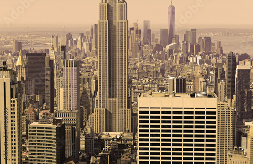 Tightly packed buildings and Manhattan skyline, New York City, sepia filter Poster