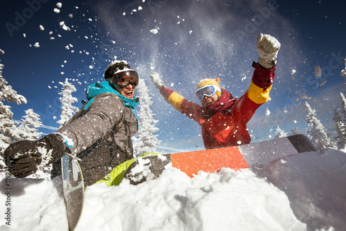 Couple of snowboarders having fun
