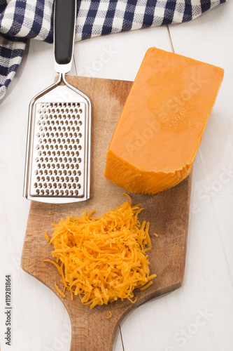 irish mature grated cheddar cheese on a wooden board
