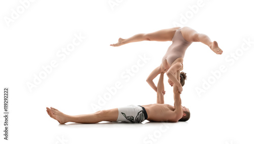 Photo  Acrobatic duo trains in studio. Isolated on white