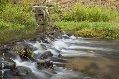Fotografia, Obraz  River Rock Dam with Culvert Dam