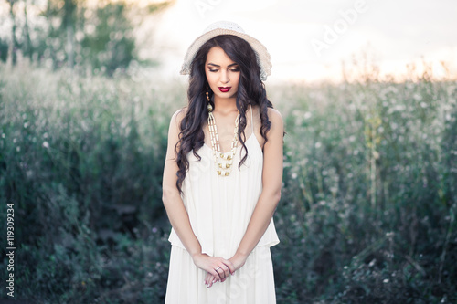 Fotografie, Tablou  Beauty Romantic Girl with white hat Outdoors