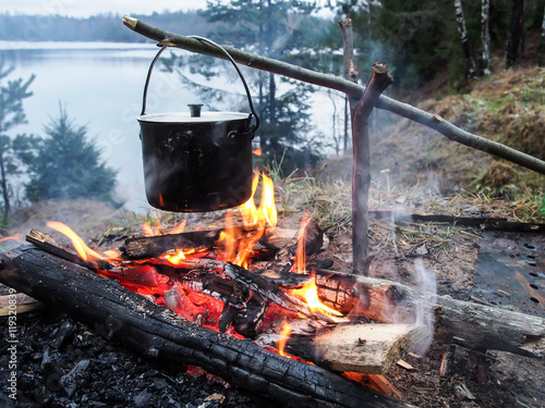 Carta da parati Cooking on the fire for a camping trip