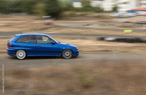 Papiers peints Nautique motorise Blue sports car on the track