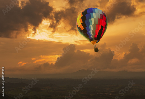 Poster Balloon Hot air balloon over the hill at sunset