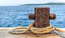 Old Rusty Steel Mooring Bollard Pole On A Pier.