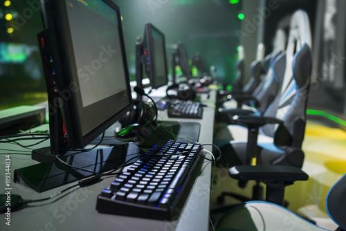 Photo  Few computer PC on desk tournament