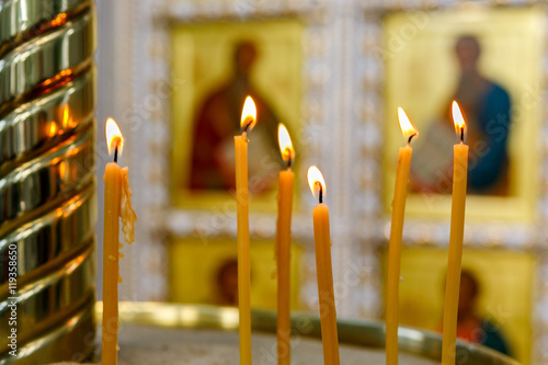 Fotomural burning candles on the background of icons in the Orthodox Church