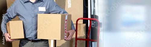 Fotografie, Obraz  Delivery man with a parcel.