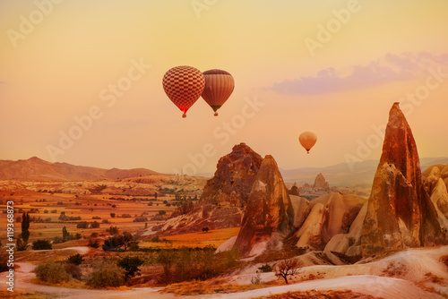 Wall Murals Photo of the day Hot air balloons flying over the picturesque Cappadocia region, Turkey