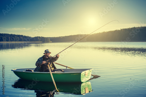 Fotografie, Obraz  man fishes in the lakes of the Mazury