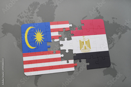 Photo  puzzle with the national flag of malaysia and egypt on a world map background