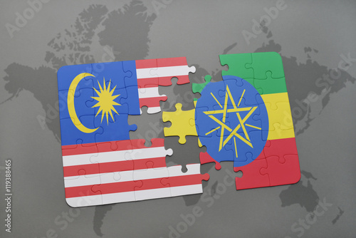 Photo  puzzle with the national flag of malaysia and ethiopia on a world map background