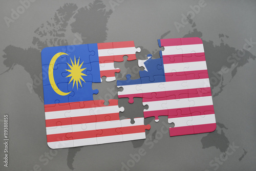 Photo  puzzle with the national flag of malaysia and liberia on a world map background
