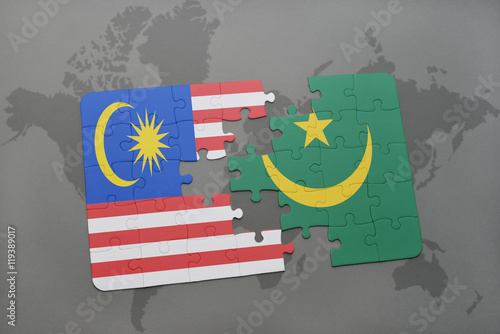Photo  puzzle with the national flag of malaysia and mauritania on a world map background