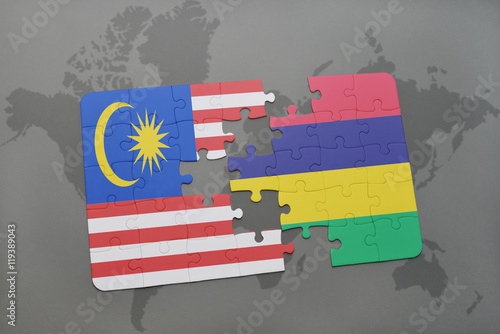 Photo  puzzle with the national flag of malaysia and mauritius on a world map background