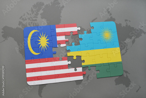 Photo  puzzle with the national flag of malaysia and rwanda on a world map background