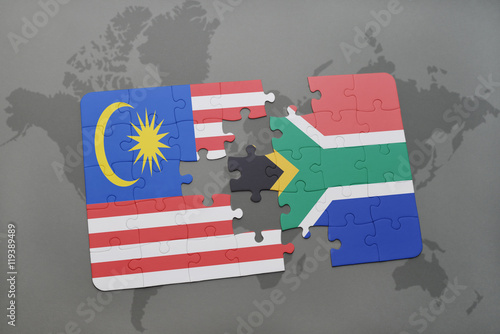 Photo  puzzle with the national flag of malaysia and south africa on a world map background