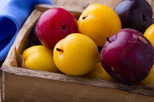 Fresh plums. Assorted colorful summer fruits