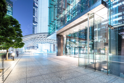 Fototapety, obrazy: modern buildings in tokyo at night from empty footpath