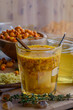 sea buckthorn honey ginger mix in glass with cinnamon