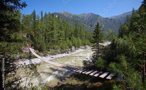 Foto auf Gartenposter Reflexion Bridge across mountain river