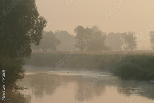 Fototapeten Natur Misty sunset on the river