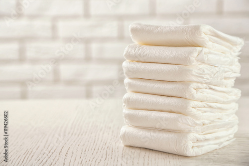 Fotografiet  Pile of diapers on the table