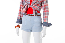 Denim Shorts With A High Waist And Plaid Shirt On A Shop Window.