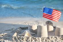 Sand Castle With American Flag On Beach