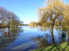 Flooded Park On The Banks Of The River Thames In Cookham, Berkshire On A Sunny Clear Winter's Day