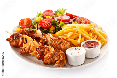 Kebab - grilled meat and vegetables on white background