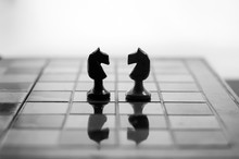 Chess Is An Strategy And Intelligence Board Game Originated In India That Is Played Between Two People On A Chessboard. Knights Face To Face.