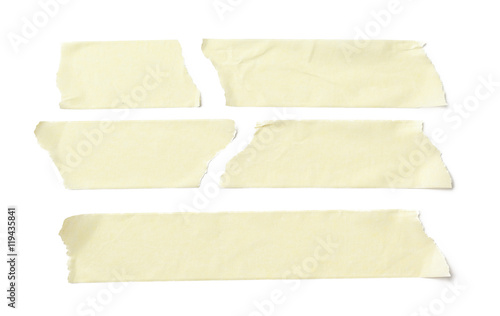 Fotomural collection of various adhesive tape pieces on white background