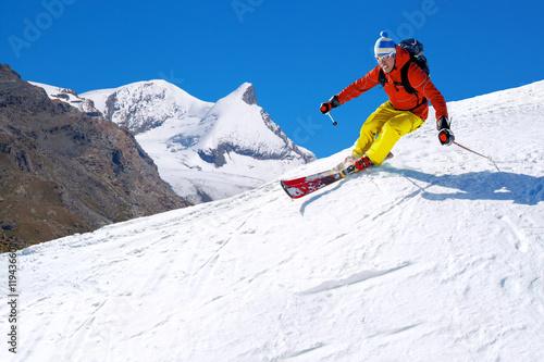 Tuinposter Wintersporten Skier skiing downhill in high mountains, Matterhorn area, Switzerland