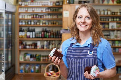 Fotografie, Obraz  Portrait Of Woman Working In Delicatessen