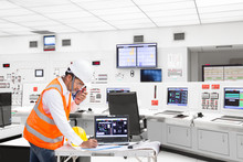 Engineer Working At Control Room Of Thermal Power Plant