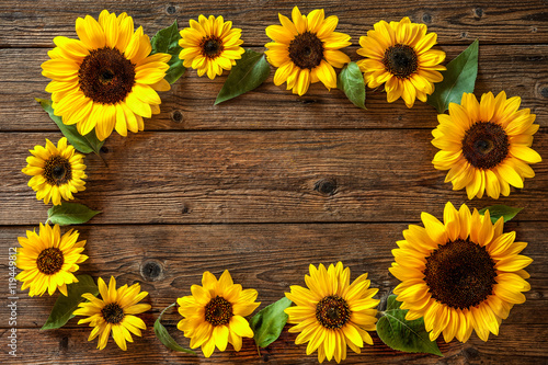 sunflowers-on-wooden-background