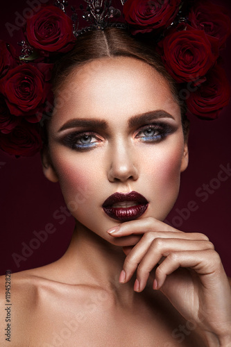 Close-up portrait of beautiful woman with dark make-up and hairstyle Canvas Print