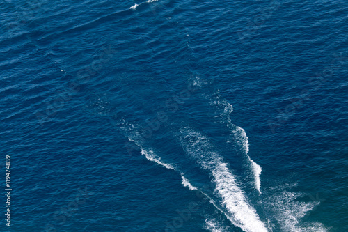 Fotografie, Obraz  trace from a boat on the surface of the water