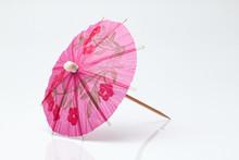 Cocktail Umbrella On A White Background.