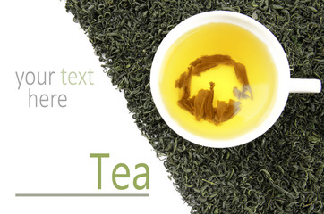 Fototapeta Do herbaciarni Cup with brewed dry tea on white background. Space for text.