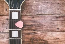 Pink Pick & Electric Guitar Fretboard, On Old Wood   Vintage Filter For Music Background