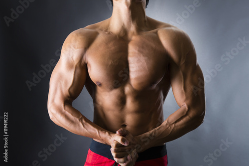 Fotografie, Obraz  力こぶをつくる男性