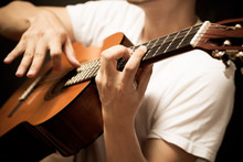 Male Musician Playing Classical, Acoustic Guitar