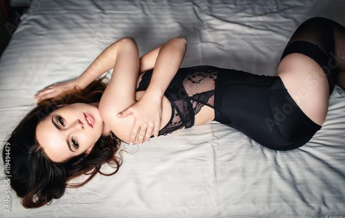 Fotografering  Beautiful girl in a black sexy lingerie